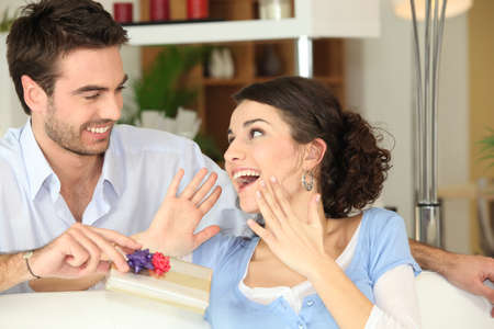special occasions: Man offering gift to wife Stock Photo
