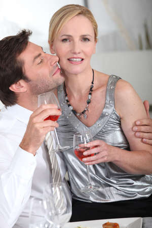 evening wear: Couple drinking a glass of wine Stock Photo