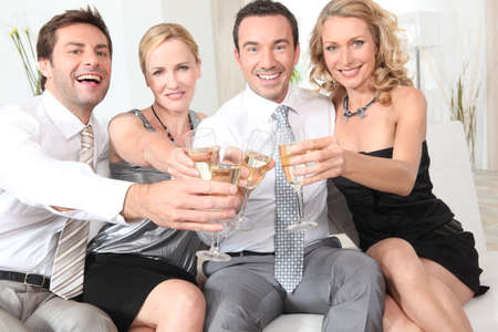 35 39 years: Two couples drinking champagne together