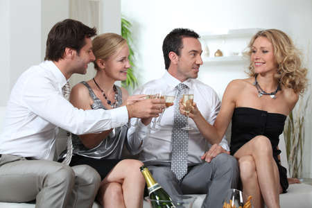 affairs: Two couples celebrating with champagne Stock Photo