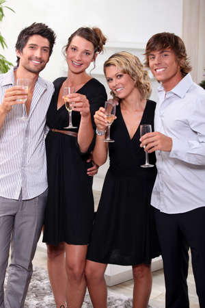 Two young couples drinking champagne photo