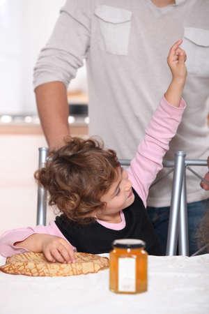 Happy child eating pancakes Stock Photo - 12088685