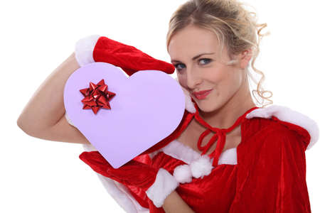 dona: Sra. Claus con una caja de bombones
