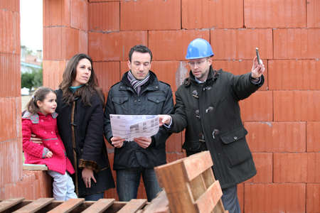 Family being shown around construction site photo