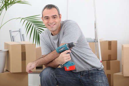 Man with an electric screwdriver photo