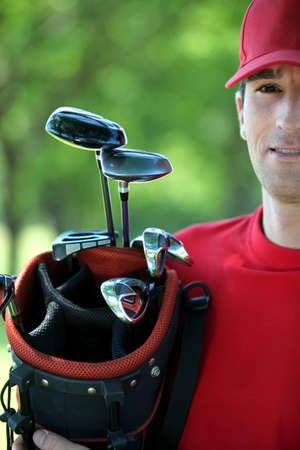 Golfer holding golf bag. photo