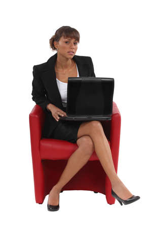Businesswoman with a laptop photo