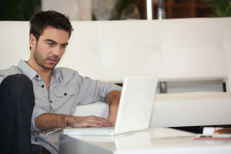 Man checking his emails photo