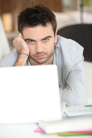 good looking man: serious-looking guy with laptop Stock Photo