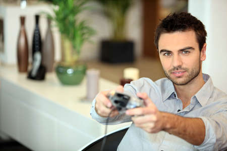 captivate: Man playing a video game