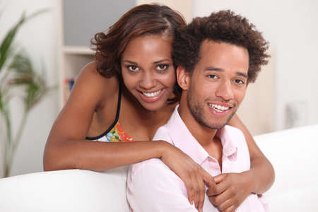 African couple relaxing at home photo