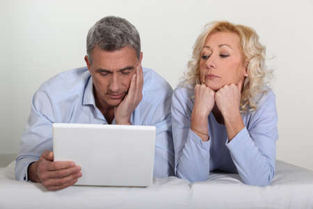 Older couple with a laptop Stock Photo - 12092874
