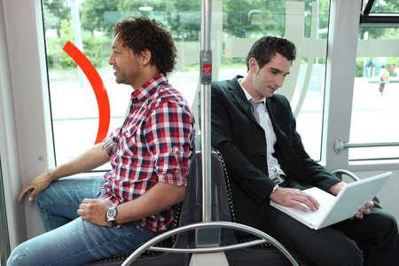 Men sitting on the bus Фото со стока