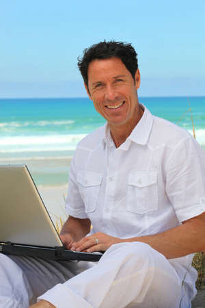 40 50: Man working on the beach.