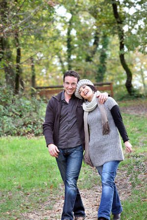Couple taking an autumnal stroll photo