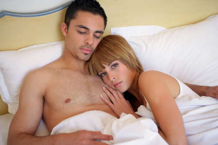 Couple laying in bed together photo
