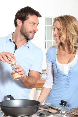 accomplices: couple cooking