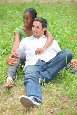 Mixed-race couple in park photo