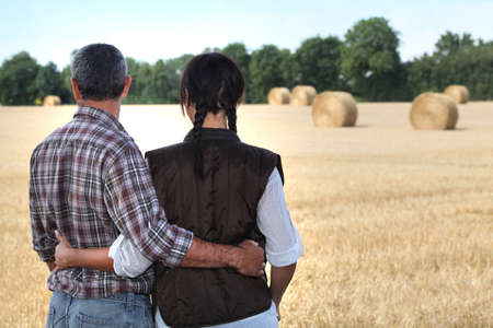 couple looking at a field photo