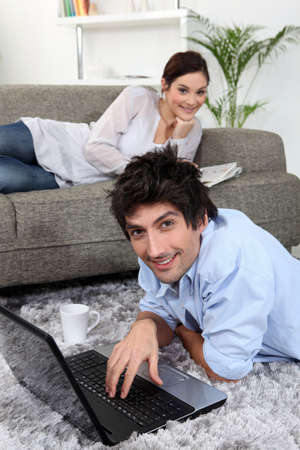 spare time: Couple relaxing at home