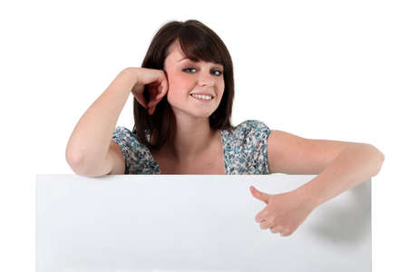 commend: Teenage girl giving the thumbs up Stock Photo