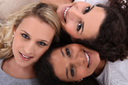 smile close up: Three female friends