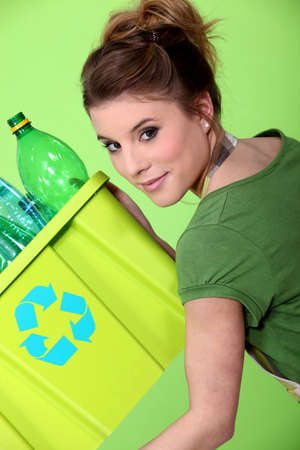 sorting: young housewife waste sorting