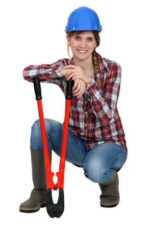 Woman kneeling by bolt cutters Stock Photo - 12091426