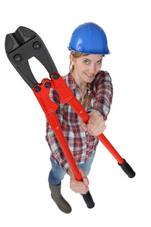Happy female builder with bolt-cutters Stock Photo - 12091293