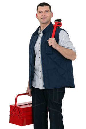 Casual worker carrying wrench and tool box photo