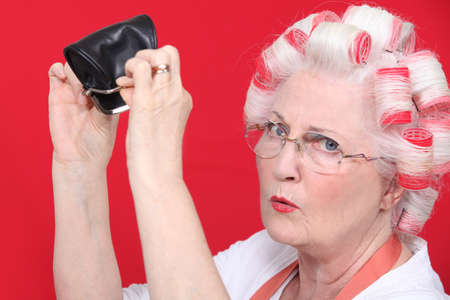 curlers: grandma with hair curlers and empty purse