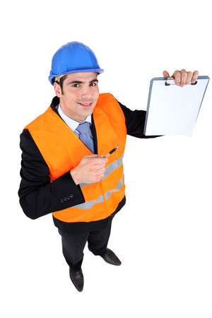 Engineering inspector with a clipboard left blank for your message photo