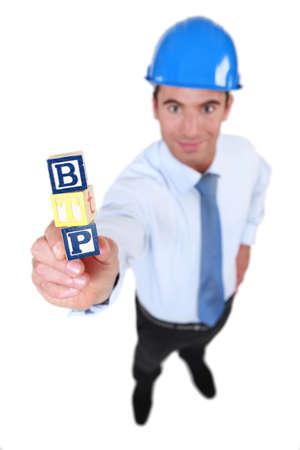 Architect holding toy building blocks photo