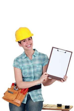 tradeswoman: Tradeswoman holding a blank clipboard