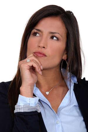slick: Thinking businesswoman Stock Photo