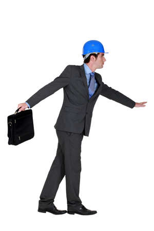 elated: elated foreman in suit holding briefcase against white background Stock Photo