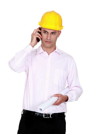 businessman wearing helmet and talking on the phone Stock Photo - 12091405