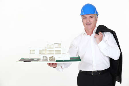 architect holding a miniature model of a house Stock Photo - 12091421