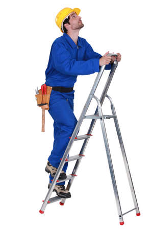 corporate ladder: Worker on a stepladder Stock Photo