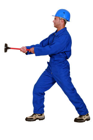 Worker with a plunger photo
