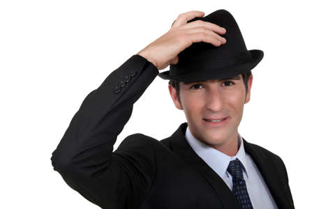 tipping: Businessman wearing trilby