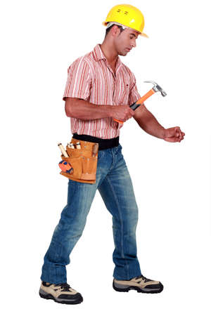 Tradesman using a hammer photo