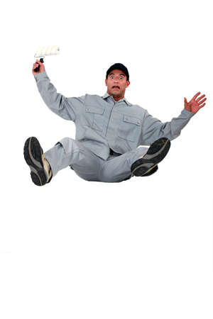 panicky: Shocked painter falling backwards Stock Photo
