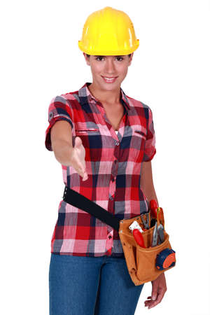 Female worker holding out hand