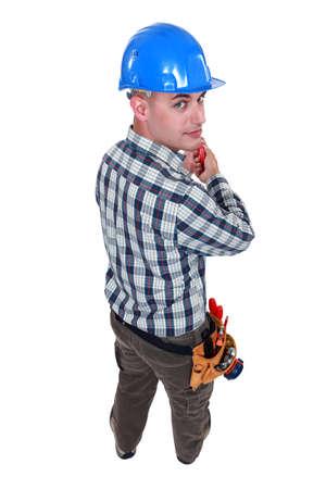 settle back: Worker holding screwdriver
