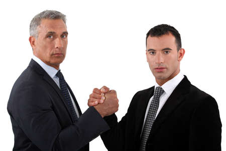 60 65 years: Businessmen forming a pact Stock Photo