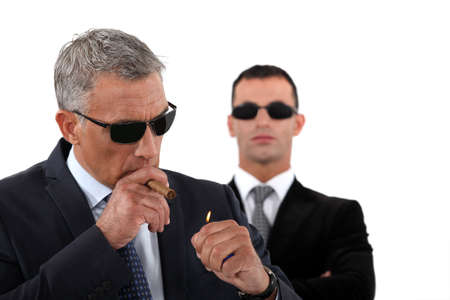 Wealthy businessman smoking cigar photo