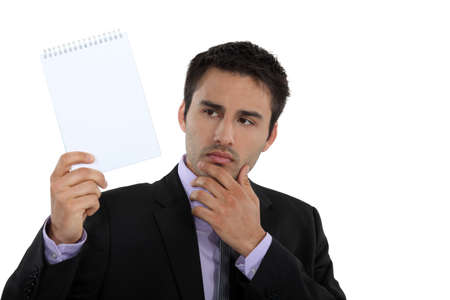 deliberate: Businessman holding up a blank notepad Stock Photo