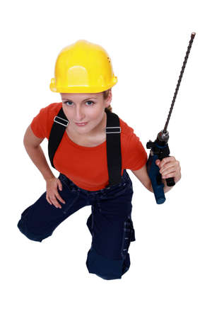 Woman with a masonry drill