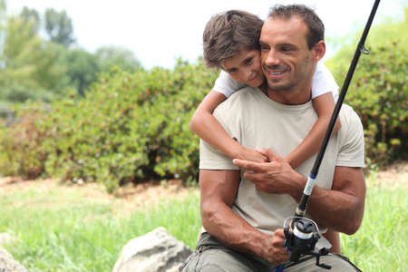 family line: Father and son on fishing trip